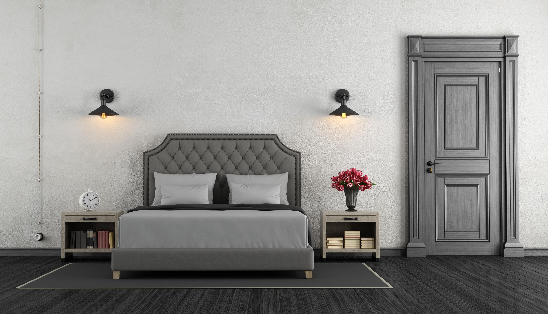 Ton-sür-ton ile kurgulanmış gri parke ve kapılı yatak odası